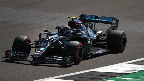 <p>               Mercedes driver Valtteri Bottas of Finland steers his car during a practice session at the 70th Anniversary Formula One Grand Prix at the Silverstone circuit, Silverstone, England, Friday, Aug. 7, 2020. (Bryn Lennon, Pool Photo via AP)             </p>