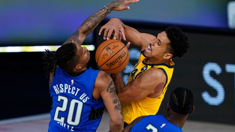 <p>               Indiana Pacers guard Malcolm Brogdon (7) and Orlando Magic guard Markelle Fultz (20) fight for a rebound during the second half of an NBA basketball game Tuesday, Aug. 4, 2020 in Lake Buena Vista, Fla. (AP Photo/Ashley Landis)             </p>