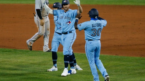 <p>               Toronto Blue Jays Travis Shaw celebrates his game-winning hit with Anthony Alford against Miami Marlins during extra innings of a baseball game, Tuesday, Aug. 11, 2020, in Buffalo, N.Y. (AP Photo/Jeffrey T. Barnes)             </p>