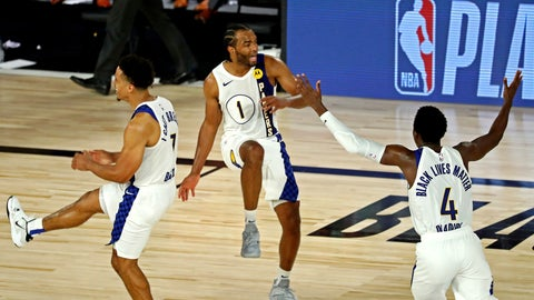 <p>               Indiana Pacers forward T.J. Warren (1) celebrates with guards Malcolm Brogdon (7) and Victor Oladipo (4) after a play against the Los Angeles Lakers during an NBA basketball game Saturday, Aug. 8, 2020, in Lake Buena Vista, Fla. (Kim Klement/Pool Photo via AP)             </p>