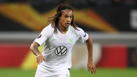 <p>               FILE - In this file photo dated Thursday, Oct. 24, 2019, Wolfsburg's Kevin Mbabu during the Europa League group I soccer match against Gent at KAA Gent Stadium in Ghent, Belgium. Wolfsburg defender Kevin Mbabu will miss his team's Europa League last-16 game against Shakhtar Donetsk after he tested positive for the coronavirus last month, the club said in a statement Monday Aug. 3, 2020.(AP Photo/Francisco Seco, FILE)             </p>