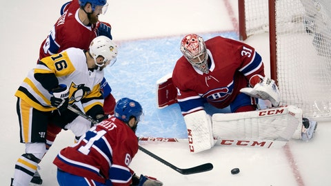 <p>               Montreal Canadiens goaltender Carey Price (31) makes a save on Pittsburgh Penguins left wing Jason Zucker (16) as Canadiens defensemen Jeff Petry (26) and Xavier Ouellet (61) help out during the first period of an NHL hockey playoff game Friday, Aug. 7, 2020, in Toronto. (Frank Gunn/The Canadian Press via AP)             </p>