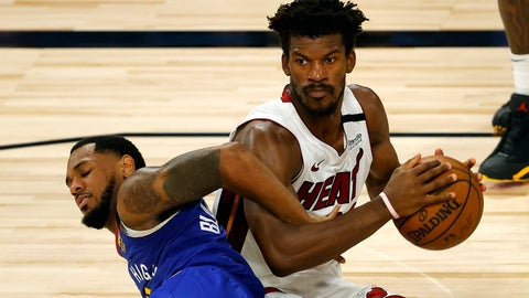 <p>               Denver Nuggets' Monte Morris tangles for the ball against Miami Heat's Jimmy Butler during an NBA basketball game, Saturday, Aug. 1, 2020, in Lake Buena Vista, Fla. (Kevin C. Cox/Pool Photo via AP)             </p>
