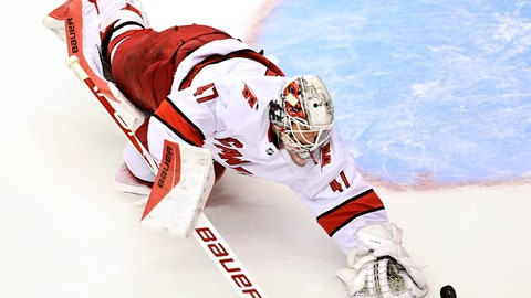 <p>               Carolina Hurricanes' goaltender James Reimer (47) reaches for a puck against the New York Rangers during second period NHL Eastern Conference Stanley Cup playoff action in Toronto on Tuesday, Aug. 4, 2020. (Frank Gunn/The Canadian Press via AP)             </p>