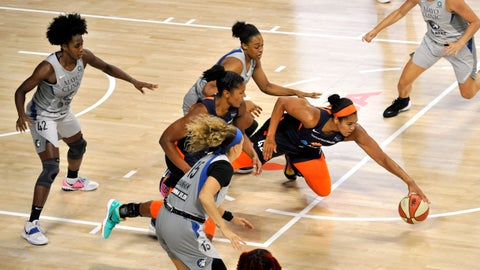 <p>               Connecticut Sun's Brionna Jones, right, reaches for a loose ball as Minnesota Lynx's Shenise Johnson (42) and Rachel Banham (15) watch during the first half of a WNBA basketball game Saturday, Aug. 1, 2020, in Bradenton, Fla. (AP Photo/Steve Nesius)             </p>