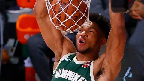 <p>               Milwaukee Bucks' Giannis Antetokounmpo (34) dunks against the Dallas Mavericks during overtime of an NBA basketball game Saturday, Aug. 8, 2020, in Lake Buena Vista, Fla. (Kevin C. Cox/Pool Photo via AP)             </p>