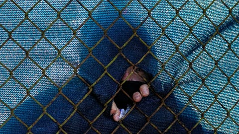 <p>               A fans watches through a hole in the fence along the the 12th hole during the first round of the PGA Championship golf tournament at TPC Harding Park Thursday, Aug. 6, 2020, in San Francisco. (AP Photo/Jeff Chiu)             </p>