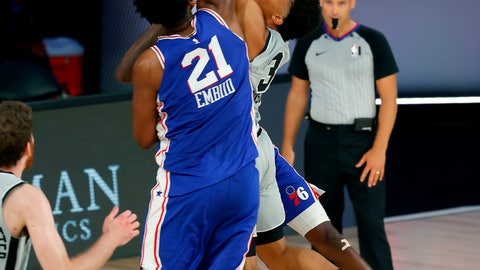 <p>               San Antonio Spurs Keldon Johnson (3) attempts a shot against Philadelphia 76ers Joel Embiid (21) during the second half of an NBA basketball game Monday, Aug. 3, 2020, in Lake Buena Vista, Fla. (Mike Ehrmann/Pool Photo via AP)             </p>