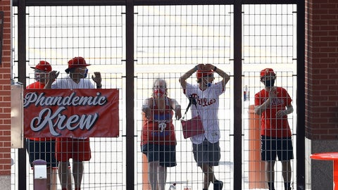 <p>               FILE - In this Aug. 5, 2020, file photo, Philadelphia Phillies fans watch from an outfield gate during the first inning of the first baseball game in doubleheader against the New York Yankees, in Philadelphia. The Phandemic Krew are the Phillies biggest fans.(AP Photo/Matt Slocum, File)             </p>