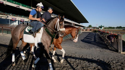 """<p>               FILE - In this June 4, 2013, file photo, Preakness winner Oxbow, left, enters the track for a light workout at Belmont Park in Elmont, N.Y. Trainer D. Wayne Lukas is at rear. The order of the Triple Crown races could be different this year. """"If you go from a mile-and-a-half and start dropping back, it's going to change a lot,"""" said Lukas, winner of 14 Triple Crown races. """"It'll change how you train, it'll change the type of horse that will end up in the Derby. It'll be a very, very significant change."""" (AP Photo/Mark Lennihan, File)             </p>"""