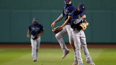 <p>               Tampa Bay Rays' Brandon Lowe, right, and Willy Adames celebrate after defeating the Boston Red Sox during a baseball game, Thursday, Aug. 13, 2020, in Boston. (AP Photo/Michael Dwyer)             </p>