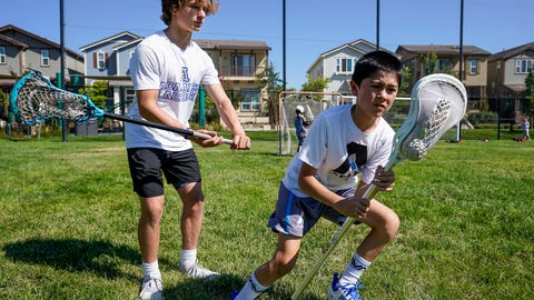 <p>               Zach Appel, right, Acalanes High School Varsity Lacrosse player, coaches 11-year-old Noah Shacklford on Tuesday, July 28, 2020 in Orinda, Calif. Zach and his friend Owen Estee have launched Lacrosse Against Hunger, to offer lacrosse coaching sessions to 7-14 year olds in exchange for a charitable donation to White Pony Express. All money raised goes directly to White Pony Express through Lacrosse Against Hunger's GoFundMe page. (AP Photo/Tony Avelar)             </p>