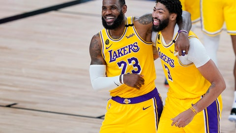 <p>               Los Angeles Lakers' LeBron James (23) and Anthony Davis (3) celebrate after defeating the Denver Nuggets 124-121 during an NBA basketball game Monday, Aug. 10, 2020, in Lake Buena Vista, Fla. (AP Photo/Ashley Landis, Pool)             </p>
