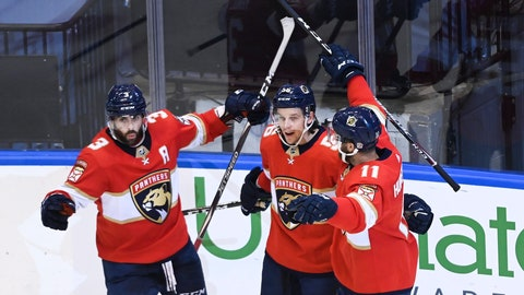 <p>               Florida Panthers left wing Erik Haula (56) celebrates his goal with teammates Keith Yandle (3) Jonathan Huberdeau (11) after scoring against the New York Islanders during the second period of an NHL Stanley Cup playoff hockey game in Toronto, Ontario, Wednesday, Aug. 5, 2020. (Nathan Denette/The Canadian Press via AP)             </p>