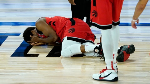 <p>               Toronto Raptors' Kyle Lowry lies on the court after being hit in the face during the second half of an NBA basketball game against the Miami Heat Monday, Aug. 3, 2020, in Lake Buena Vista, Fla. (AP Photo/Ashley Landis, Pool)             </p>