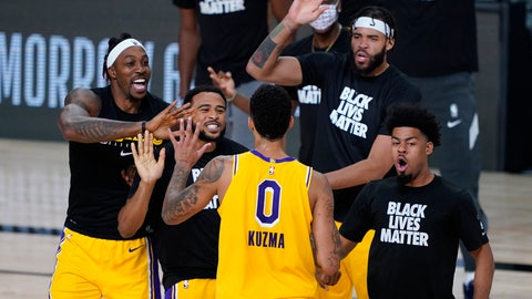 <p>               Los Angeles Lakers' Kyle Kuzma (0) is congratulated by teammates after hitting a game-winning 3-pointer against the Denver Nuggets during the second half of an NBA basketball game Monday, Aug. 10, 2020, in Lake Buena Vista, Fla. The Lakers won 124-121. (AP Photo/Ashley Landis, Pool)             </p>