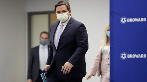 """<p>               Florida Gov. Ron DeSantis arrives at a news conference, Monday, Aug. 3, 2020, at the Broward Health Corporate Office in Fort Lauderdale, Fla. On Friday, the governor's office released a video promoting """"One Goal One Florida,"""" a public service campaign that also urges Floridians to keep their distance and wear masks as a way to lower the risk of coronavirus infections. (AP Photo/Wilfredo Lee)             </p>"""