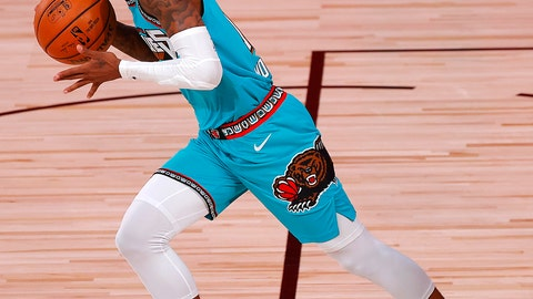 <p>               Ja Morant of the Memphis Grizzlies' dribbles the ball down court during the first half of an NBA basketball game Sunday, Aug. 9, 2020, in Lake Buena Vista, Fla. (Kevin C. Cox/Pool Photo via AP)             </p>