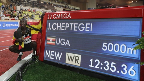 <p>               Uganda's Joshua Cheptegei poses next to the timing board after winning the men's 5000 meters race in a new world record time of 12:35.36 during the Diamond League athletics meeting at the Louis II stadium in Monaco Friday, Aug. 14, 2020.(Valery Hache /Pool Via AP)             </p>