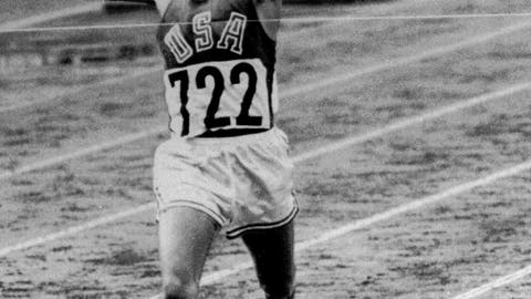 <p>               FILE - In this Oct. 14, 1964, file photo, U.S. Marine Lt. Billy Mills pulls off a stunning upset by winning the 10,000 meters Olympic race in Tokyo. Mills set an Olympic record 0f 28:24:4, and was the only American ever to win the event. (AP Photo/File)             </p>