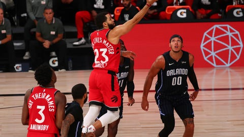 <p>               Toronto Raptors guard Fred VanVleet (23) shoots against Orlando Magic forward James Ennis III (11) and forward Aaron Gordon (00) in the second half of an NBA basketball game Wednesday, Aug. 5, 2020, in Lake Buena Vista, Fla. (Kim Klement/Pool Photo via AP)             </p>