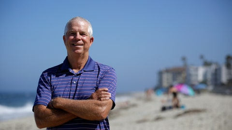 <p>               Peter Schnugg stands for a portrait along the beach Friday, July 31, 2020, in San Diego. The former waterpolo athlete missed his chance to go to the Olympics in 1980 when the U.S. decided to boycott the games to protest the Soviet Union's invasion of Afghanistan. Now he's unsure if he'll get the chance to see his niece, Maggie Steffens, try for a third consecutive gold medal with the U.S. women's water polo team. (AP Photo/Gregory Bull)             </p>