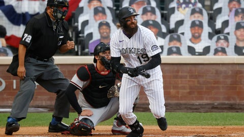 <p>               Colorado Rockies' Charlie Blackmon, front, follows the flight of his single as he breaks from the batter's box as Arizona Diamondbacks catcher Carson Kelly, back right, and home plate umpire Alfonso Marquez look on in the first inning of a baseball game Tuesday, Aug. 11, 2020, in Denver. (AP Photo/David Zalubowski)             </p>