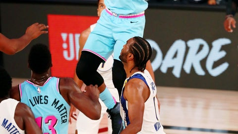 <p>               Miami Heat forward Jimmy Butler (22) makes a jumping pass against the Indiana Pacers during the second half of an NBA basketball game Monday, Aug. 10, 2020, in Lake Buena Vista, Fla. (Kim Klement/Pool Photo via AP)             </p>