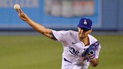 <p>               Los Angeles Dodgers relief pitcher Joe Kelly throws to the plate during the eighth inning of a baseball game against the San Francisco Giants Friday, Aug. 7, 2020, in Los Angeles. (AP Photo/Mark J. Terrill)             </p>