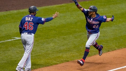 <p>               Minnesota Twins' Eddie Rosario celebrates his grand slam with third base coach Tony Diaz during the third inning of a baseball game against the Milwaukee Brewers Monday, Aug. 10, 2020, in Milwaukee. (AP Photo/Morry Gash)             </p>