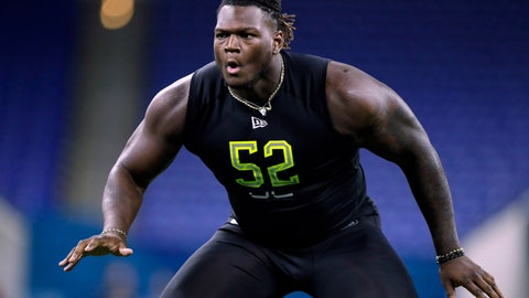 <p>               FILE - In this Feb. 28, 2020, file photo, Georgia offensive lineman Isaiah Wilson runs a drill at the NFL football scouting combine in Indianapolis. The Tennessee Titans have placed their top draft pick, offensive lineman Isaiah Wilson, on the COVID-19/reserve list. The former Georgia star remains the one member of their six-man draft class that has yet to agree to a contract. (AP Photo/Michael Conroy, File)             </p>