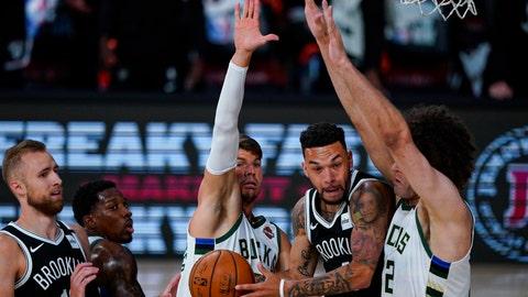 <p>               Brooklyn Nets guard Chris Chiozza (4) cuts between Milwaukee Bucks guard Kyle Korver (26) and center Robin Lopez (42) during the first half of an NBA basketball game Tuesday, Aug. 4, 2020 in Lake Buena Vista, Fla. (AP Photo/Ashley Landis)             </p>