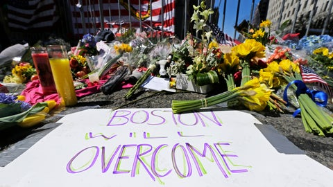 <p>               FILE - In this April 17, 2013 photograph, flowers and signs adorn a barrier, two days after two explosions killed three and injured hundreds, at Boylston Street near the of finish line of the Boston Marathon at a makeshift memorial for victims and survivors of the bombing.  A federal appeals court has overturned the death sentence of Dzhokhar Tsarnaev in the 2013 Boston Marathon bombing, Friday, July 31, 2020, saying the judge who oversaw the case didn't adequately screen jurors for potential biases.    (AP Photo/Charles Krupa, File)             </p>