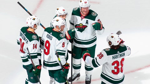 <p>               Minnesota Wild's Joel Eriksson Ek (14), Mikko Koivu (9), Jared Spurgeon (46), Ryan Suter (20) and Ryan Hartman (38) celebrate Spurgeon's goal against the Vancouver Canucks during the third period of an NHL hockey playoff game Sunday, Aug. 2, 2020, in Edmonton, Alberta. (Codie McLachlan/The Canadian Press via AP)             </p>