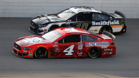 <p>               Kevin Harvick (4) races Aric Almirola (10) during the NASCAR Cup Series auto race at Michigan International Speedway in Brooklyn, Mich., Sunday, Aug. 9, 2020. (AP Photo/Paul Sancya)             </p>