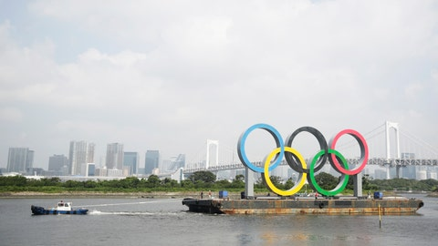 "<p>               A tugboat moves a symbol installed for the Olympic and Paralympic Games Tokyo 2020 on a barge moved away from its usual spot off the Odaiba Marine Park in Tokyo Thursday, Aug. 6, 2020. The five Olympic rings floating on a barge in Tokyo Bay were removed for what is being called ""maintenance,"" and officials says they will return to greet next year's Games. The Tokyo Olympics have been postponed for a year because of the coronavirus pandemic and are to open on July 23, 2021. The Paralympics follow on Aug. 24. (AP Photo/Hiro Komae)             </p>"
