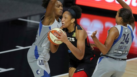 <p>               Las Vegas Aces' A'ja Wilson drives between Minnesota Lynx's Kayla Alexander (40) and Napheesa Collier during the first half of a WNBA basketball game Thursday, Aug. 13, 2020, in Bradenton, Fla. (AP Photo/Mike Carlson)             </p>