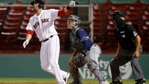 <p>               Boston Red Sox's J.D. Martinez, left, follows through on his grand slam in front of Tampa Bay Rays' Michael Perez during the eighth inning of a baseball game, Wednesday, Aug. 12, 2020, in Boston. (AP Photo/Michael Dwyer)             </p>