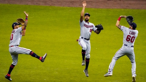 <p>               Minnesota Twins' Eddie Rosario, Byron Buxton and Jake Cave celebrate after a baseball game against the Milwaukee Brewers Wednesday, Aug. 12, 2020, in Milwaukee. The Twins won 12-2. (AP Photo/Morry Gash)             </p>