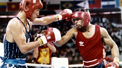<p>               FILE - In this Oct. 2, 1988, file photo, South Korea's Park Si-hun, left, delivers a left jab to America's Roy Jones, and goes on to win the gold medal in the gold medal bout of the light middleweight division at the summer Olympics in Seoul, South Korea. (AP Photo/Ron Kutz, File)             </p>