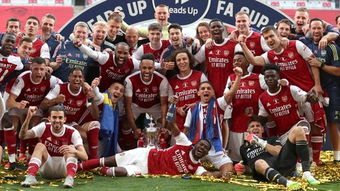 <p>               Arsenal's Pierre-Emerick Aubameyang holds the trophy celebrating with team mates players celebrate with the trophy after the FA Cup final soccer match between Arsenal and Chelsea at Wembley stadium in London, England, Saturday, Aug.1, 2020. (Catherine Ivill/Pool via AP)             </p>