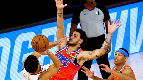 <p>               Phoenix Suns' Devin Booker, left, tries to shoot past Oklahoma City Thunder's Abdel Nader, center, during the first half of an NBA basketball game Monday, Aug. 10, 2020, in Lake Buena Vista, Fla. (Mike Ehrmann/Pool Photo via AP)             </p>