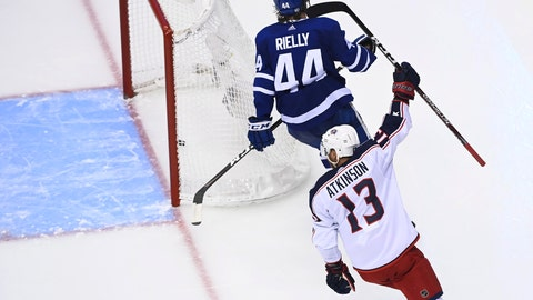 <p>               Columbus Blue Jackets right wing Cam Atkinson (13) celebrates his goal as Toronto Maple Leafs defenseman Morgan Rielly (44) skates nearby during the third period of an NHL hockey playoff game in Toronto, Sunday, Aug. 2, 2020. (Nathan Denette/The Canadian Press via AP)             </p>