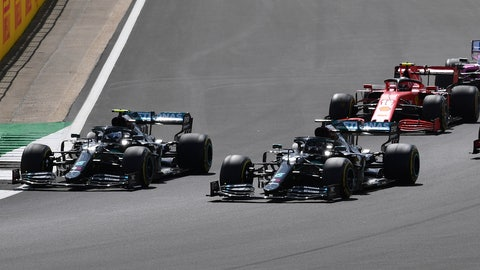 <p>               Mercedes driver Valtteri Bottas of Finland, left and Mercedes driver Lewis Hamilton of Britain steer their cars during the British Formula One Grand Prix at the Silverstone racetrack, Silverstone, England, Sunday, Aug. 2, 2020. (Ben Stansall/Poolvia AP)             </p>