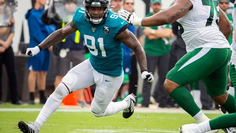 <p>               FILE - In this Oct. 27, 2019, file photo, Jacksonville Jaguars defensive end Yannick Ngakoue (91) rushes New York Jets quarterback Sam Darnold (14) during the first half of an NFL football game, in Jacksonville, Fla. When or if Yannick Ngakoue returns to the Jacksonville Jaguars, the disgruntled defensive end will need several introductions. The Jaguars have been forced to revamp their defensive line during the first two weeks of training camp, and they don't appear done. (AP Photo/Stephen B. Morton, File)             </p>