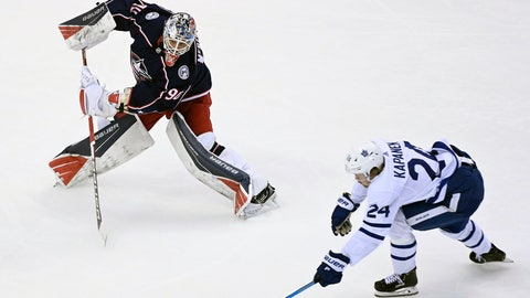 <p>               Columbus Blue Jackets goaltender Elvis Merzlikins (90) comes far out of his net to play the puck as Toronto Maple Leafs right wing Kasperi Kapanen (24) chases during the second period of an NHL hockey playoff game  Thursday, Aug. 6, 2020, in Toronto. (Nathan Denette/The Canadian Press via AP)             </p>