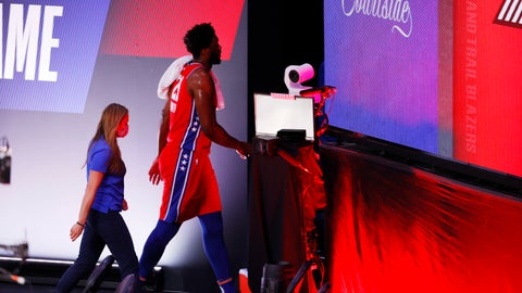 <p>               Philadelphia 76ers' Joel Embiid (21) leaves an NBA basketball game against the Portland Trail Blazers, Sunday, Aug. 9, 2020, in Lake Buena Vista, Fla. (Kevin C. Cox/Pool Photo via AP)             </p>
