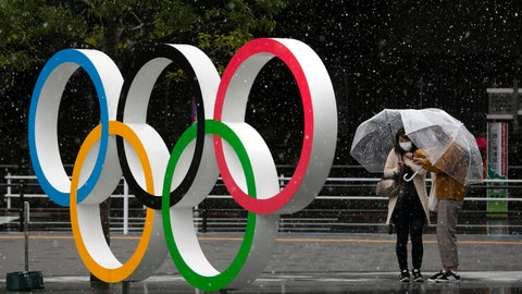 <p>               FILE - In this March 14, 2020, file photo, snow falls on the Olympic Rings near the New National Stadium in Tokyo. Day 11 of the postponed Tokyo Olympics finally brought what was feared the most before the pandemic postponed the games for a year: A hot and humid Tokyo summer day. (AP Photo/Jae C. Hong, File)             </p>