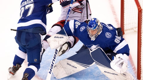 <p>               Tampa Bay Lightning defenseman Ryan McDonagh (27) hits Columbus Blue Jackets right wing Oliver Bjorkstrand (28) as Lightning goaltender Andrei Vasilevskiy (88) watches during the second overtime period in Game 1 of an NHL hockey Stanley Cup first-round playoff series, Tuesday, Aug. 11, 2020, in Toronto. (Frank Gunn/The Canadian Press via AP)             </p>