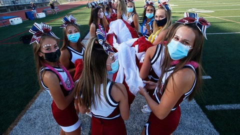 <p>               Herriman cheerleaders carry the American flag before the start of a high school football game against Davis, on Thursday, Aug. 13, 2020, in Herriman, Utah. Utah is among the states going forward with high school football this fall despite concerns about the ongoing COVID-19 pandemic that led other states and many college football conferences to postpone games in hopes of instead playing in the spring. (AP Photo/Rick Bowmer)             </p>